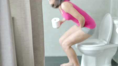 toilets : pan shot of woman feel pain with constipation in wc