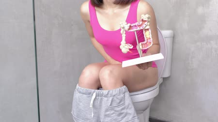 sanitário : woman with colorectal cancer in the toilet