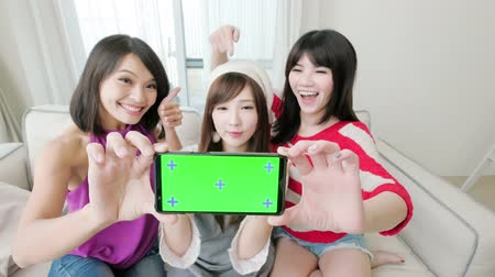 bestie : young girl show screen to you and smile happily, focus on the phone Stock Footage