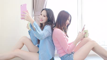 bestie : two beauty woman selfie happily on the bed