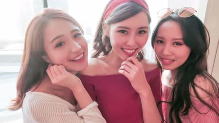 bestie : three beauty woman smile to you in the restaurant Stock Footage