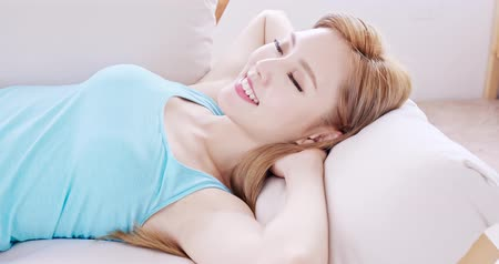 gauč : woman sleep and feel free on sofa at home