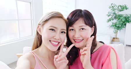 livingroom : daughter selfie with her mother happiy at home Stock Footage