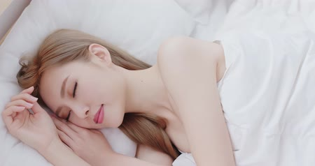 laying : woman sleep on the bed at home in morning Stock Footage