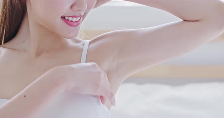 woman waxing : beauty woman smile with clean underarm at home Stock Footage