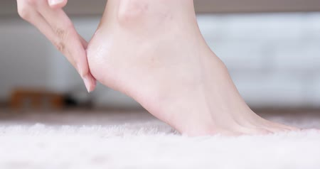 clean room : beauty woman use cream with foot at home Stock Footage