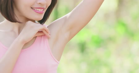 barbear : woman with underarm hair removal concept with green background