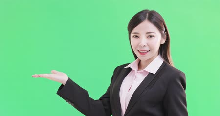 wizja : businesswoman show something to you on the green background