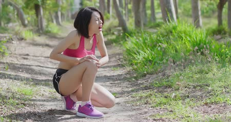 diz : sport woman feel pain with knee injury in the forest