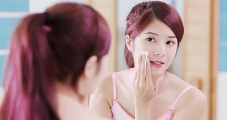 human face : woman use cleansing cotton in the bathroom Stock Footage