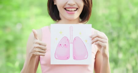 seio : woman take health lung billboard and thumb up with green background Stock Footage