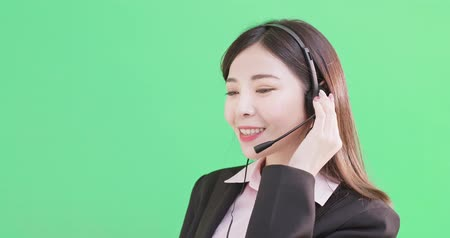 телефон доверия : businesswoman wear phone headset on the green background