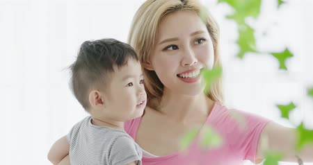 opona : mommy hug her son and smile happily at home
