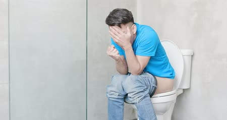sanitário : man feel pain with constipation in wc