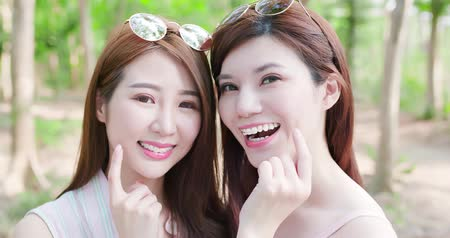 removable : two beauty women wear brace and retainer show her teeth