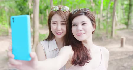 removable : two beauty women wear brace and retainer for teeth selfie happily