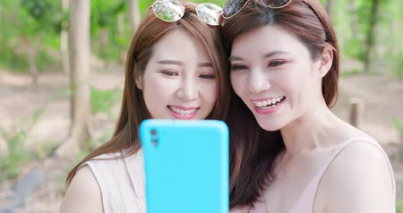 bracket : two beauty women wear brace and retainer for teeth selfie happily