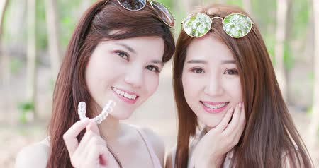 bestie : two beauty women wear brace and smile happily Stock Footage