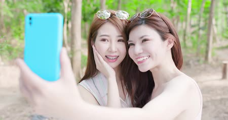 bestie : two beauty women wear brace and retainer for teeth selfie happily