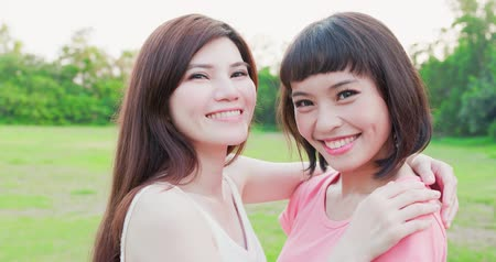 dente : two women smile happily on the outdoor