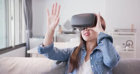 vr headset : woman wear virtual reality headset and touch something Stock Footage