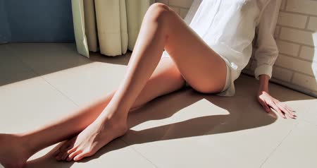 woman waxing : beauty woman shows her sexy legs in the room