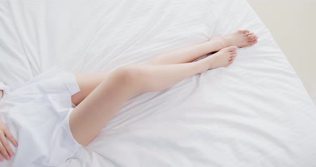 woman waxing : beauty woman lying on the bed with sexy legs Stock Footage