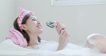 shower room : beauty woman wash body and sing song in bathtub Stock Footage