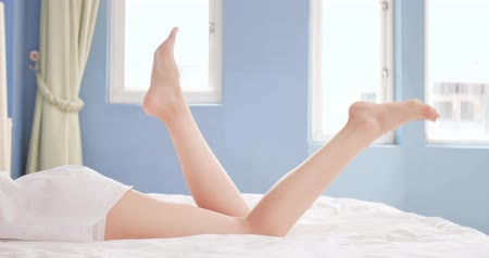 woman waxing : beauty woman lying on the bed showing sexy legs