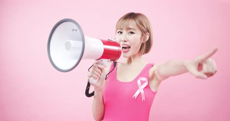 rakovina : woman take microphone and show something with prevention breast cancer