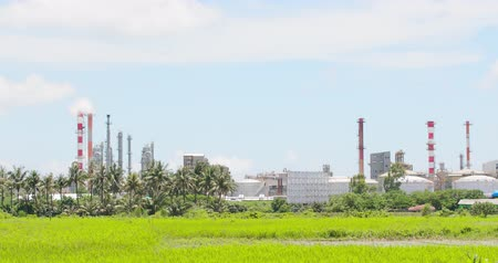 zöld fű : Tainan, Taiwan - June 29, 2018: factory with air pollution concept