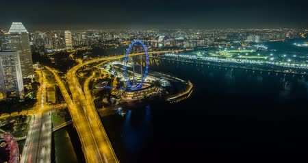 largest city : Giant ferris Wheel, Singapore - July 24, 2018: Timelapse view showing the largest Giant Observation Wheel in the world Stock Footage