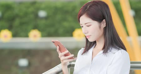 internar : business woman smile happily and use phone