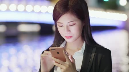 a smile : woman use phone in city at night