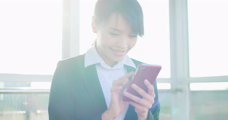 tainan : business woman use phone in the station Stock Footage
