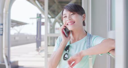 tainan : woman speak on phone happily in the Station