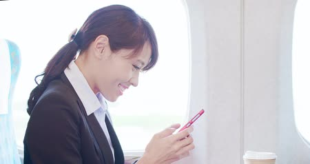 chamada : business woman use phone with coffee in the train