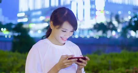 mobile game : Woman play mobile game happily at night
