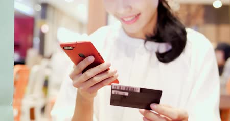 nfc : woman use phone and credit card in the shopping mall