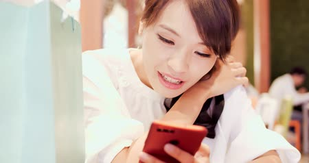 phone call screen : woman use phone happily in the shopping mall