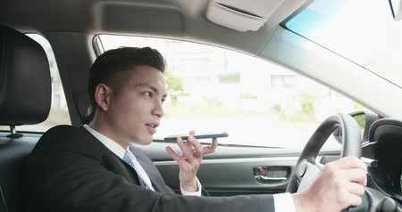 discurso : business man send audio message by smart phone in the car