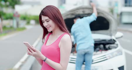 meteliksiz : young woman using mobile phone and do not worry with broken down car on street