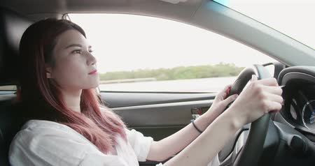 ülés : business woman driving happily in the car Stock mozgókép