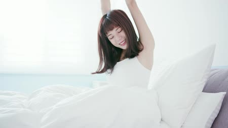 a smile : beauty women wake up from sleep and feel happy in the morning