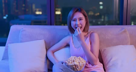 watch tv : Young woman watch comedy and feel funny at night Stock Footage