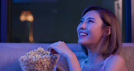 hassaslık : Young woman cry while watching a very moving movie at night