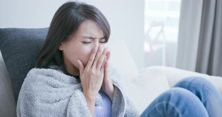 handkerchief : sick woman get a cold and cough at home