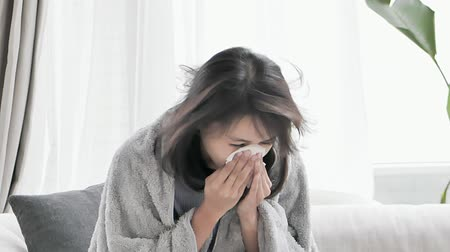alergia : slow motion of woman sick and sneeze with tissue paper at home Vídeos