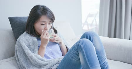 мигрень : woman get a cold and feel better after drink hot tea at home