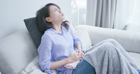 painéis : woman feel pain with stomach ache and menstruation at home